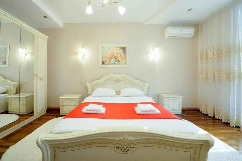 A bed or beds in a room at Five Stars Luxury Revolution square