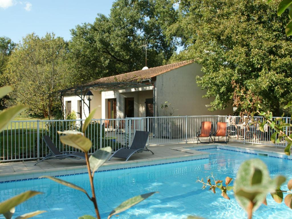 The swimming pool at or near Quaint Bungalow in Pinsac with a Pool