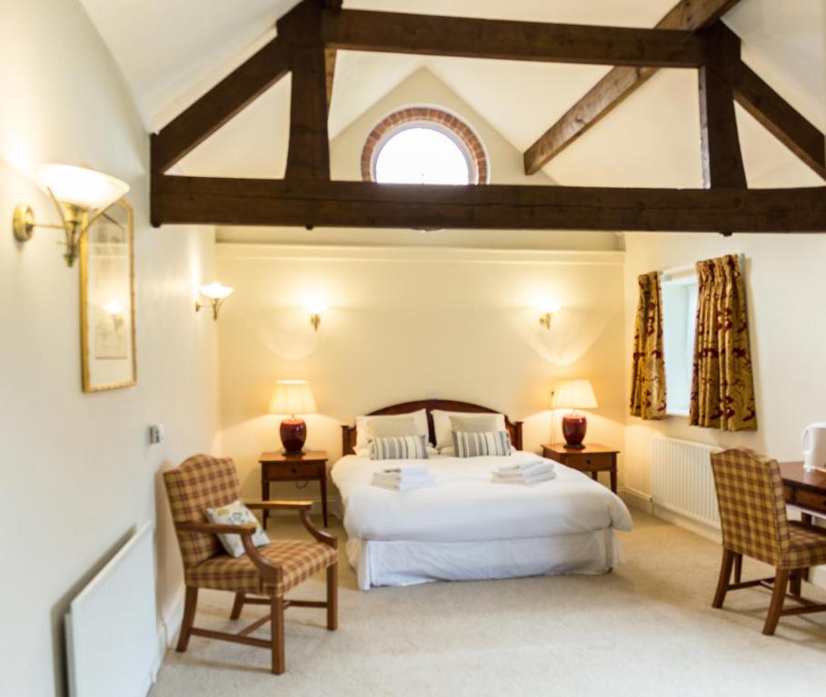 A bed or beds in a room at The Bull Inn