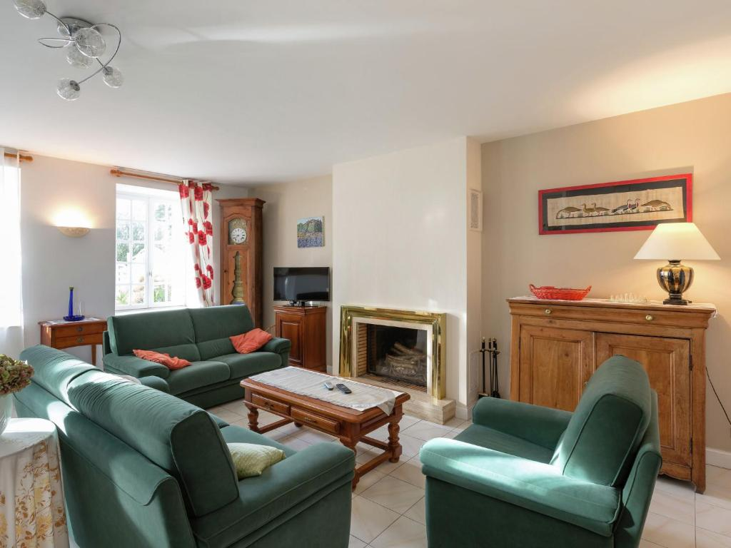 A seating area at Spacious Holiday Home in Lanrelas with Garden