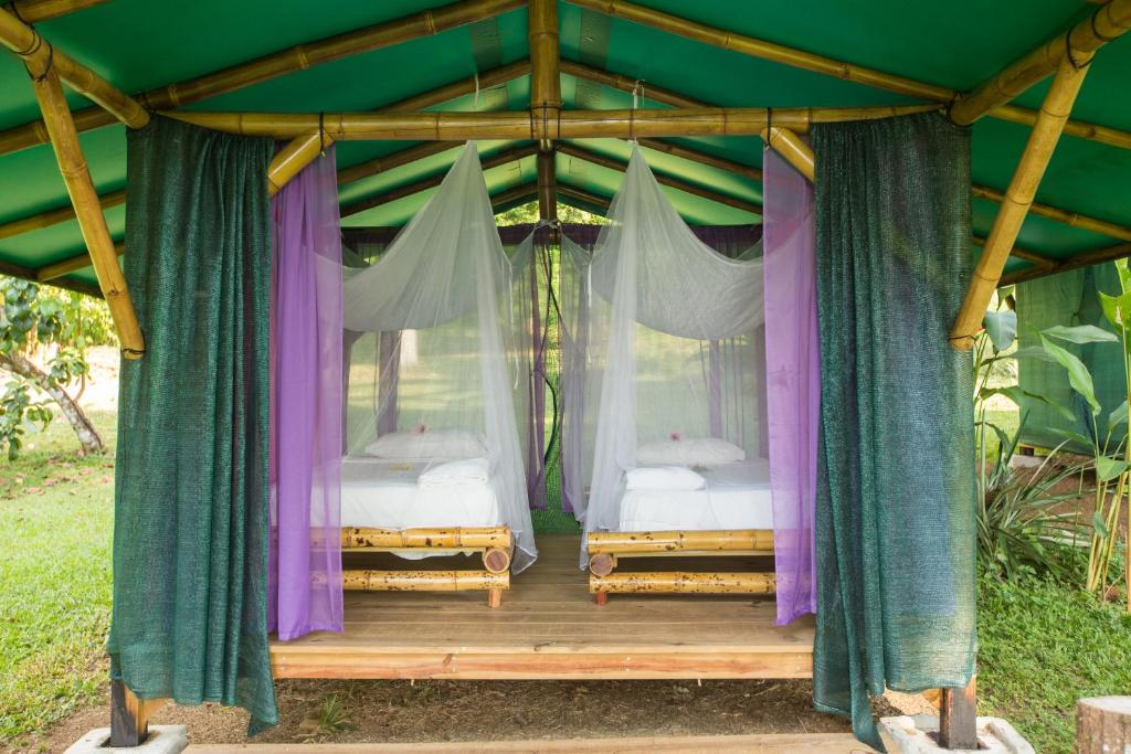 A bed or beds in a room at Saladero Ecolodge