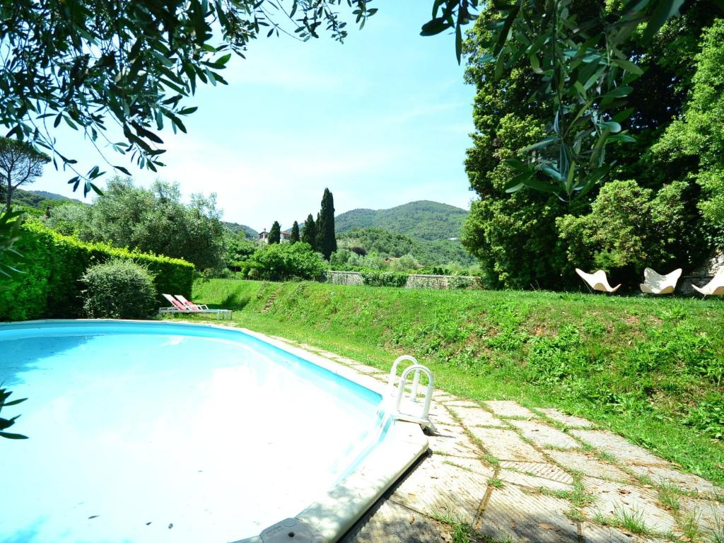 The swimming pool at or near Charming Holiday Home in Tuscany near Lake Puccini