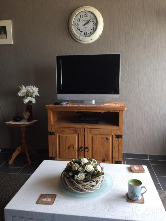 A television and/or entertainment center at Residentie Maria Lucia