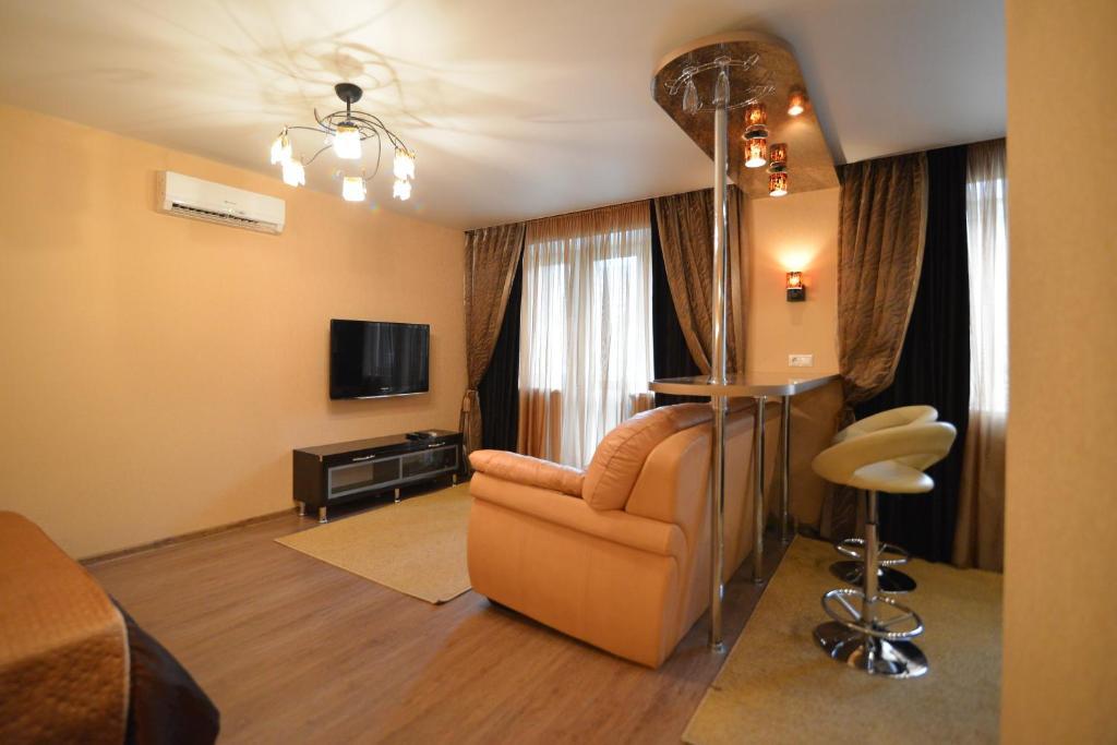 Гостиная зона в Renta36 Apartment on Kutsygina 30