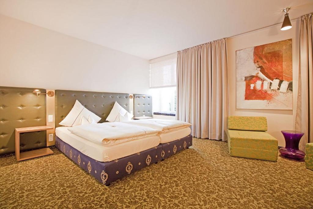 Ein Bett oder Betten in einem Zimmer der Unterkunft Hotel Lehmeier