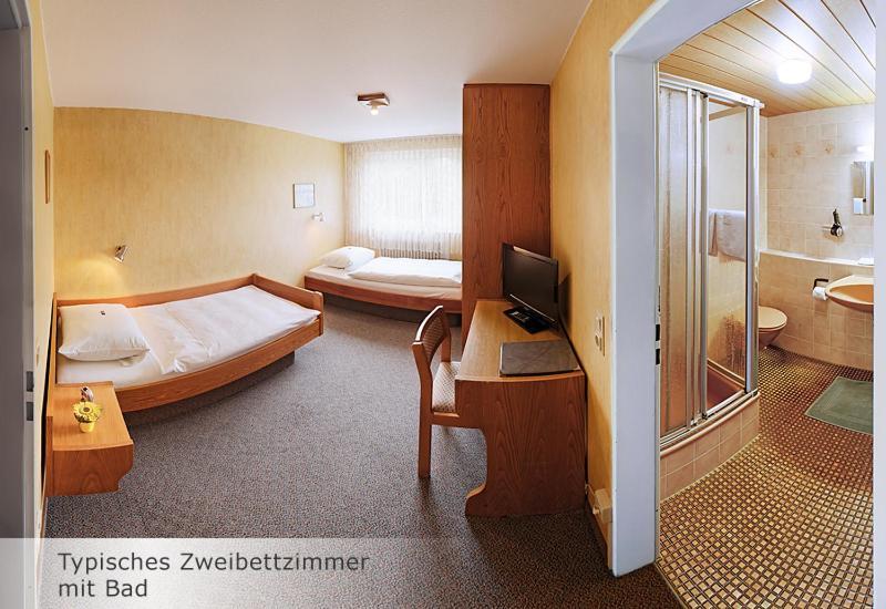 Кровать или кровати в номере Hotel Keinath Stuttgart