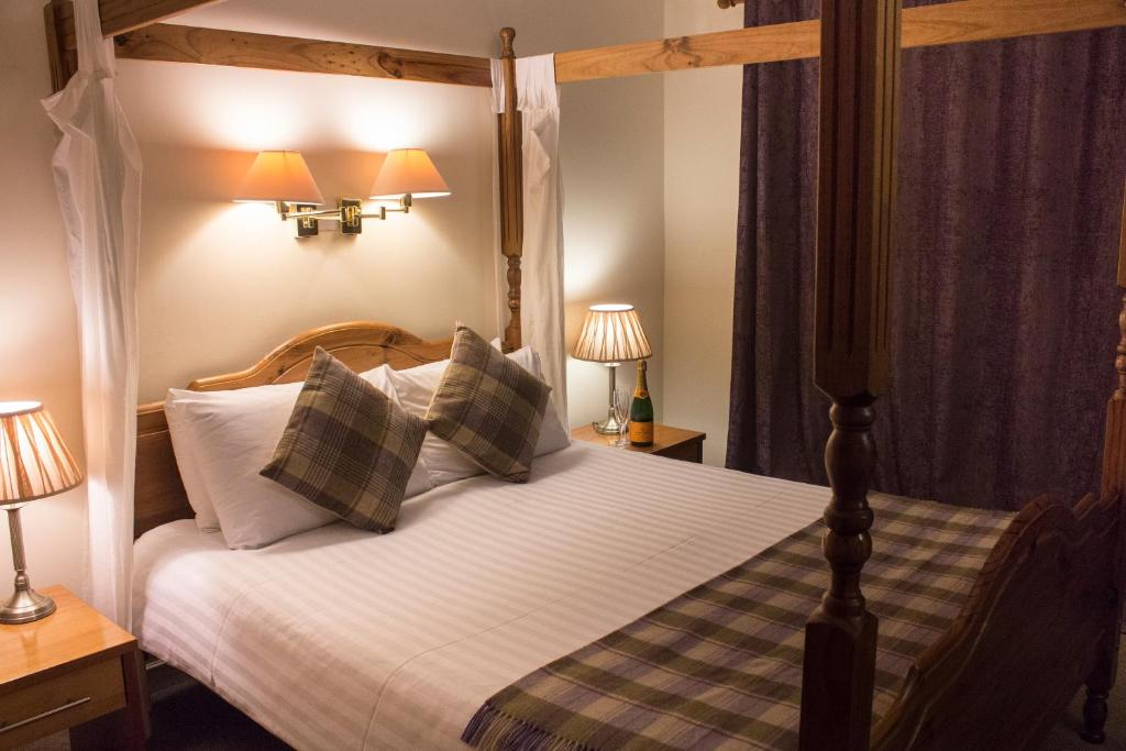 A bed or beds in a room at The Lomond Hills Hotel