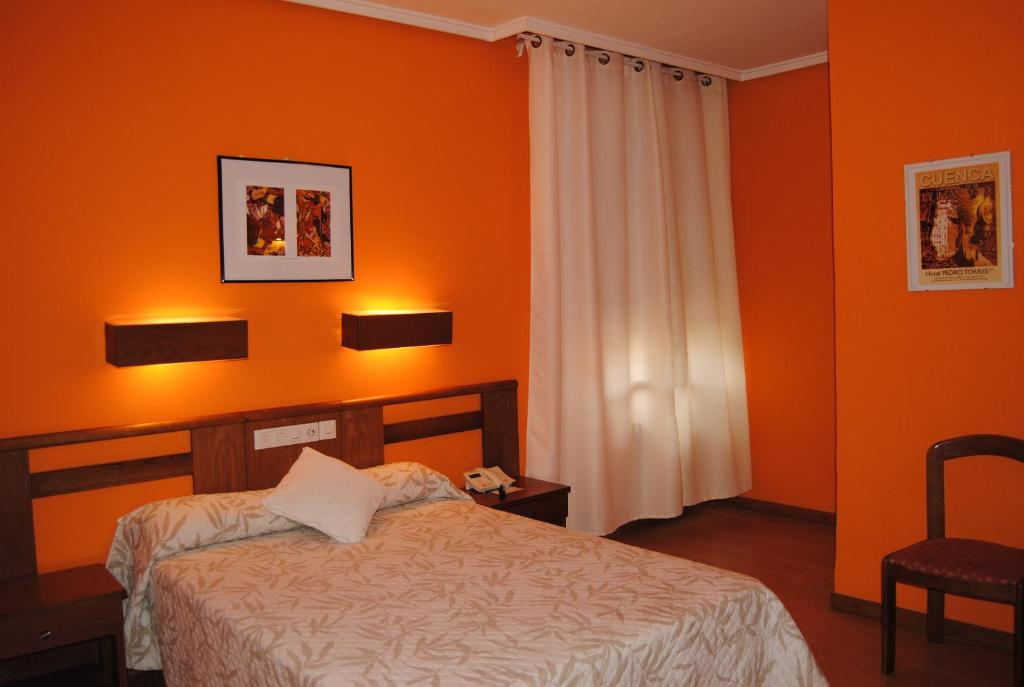 A bed or beds in a room at Hotel Pedro Torres