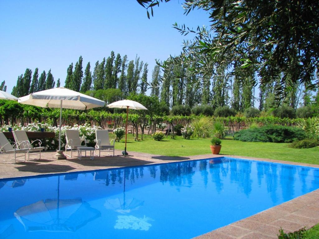 The swimming pool at or near Conalbi Grinberg Casa Vinicola
