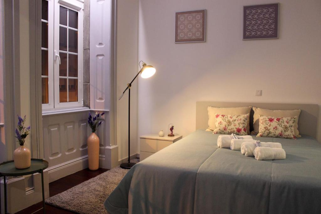 A bed or beds in a room at Charme e Alegria