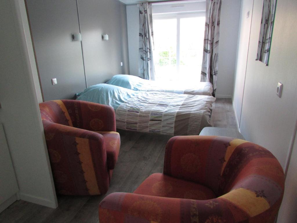 Un ou plusieurs lits dans un hébergement de l'établissement Etretat's Motel