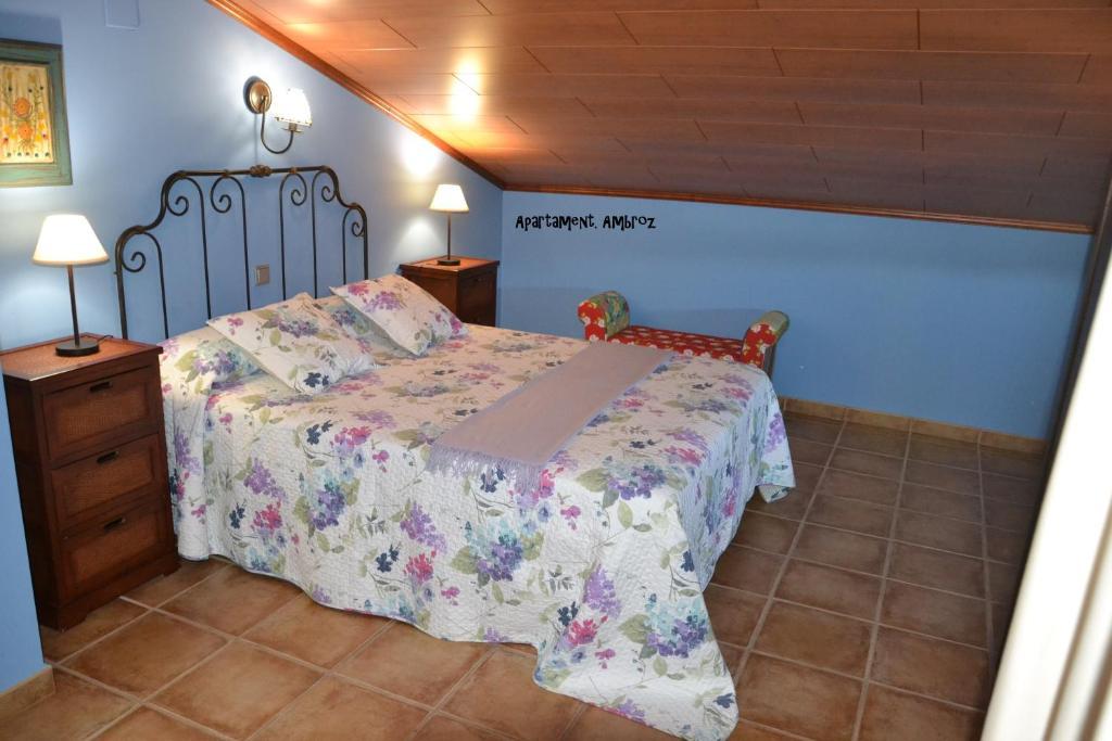 A bed or beds in a room at Apartamentos Rurales Natura
