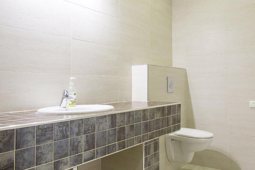 Ванная комната в Apartment In Ideal House 2