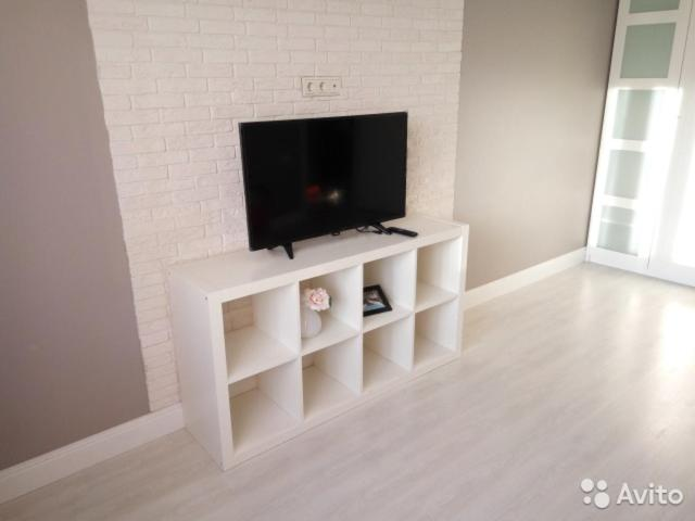 A television and/or entertainment centre at Apartments Crocus&Snezhkom