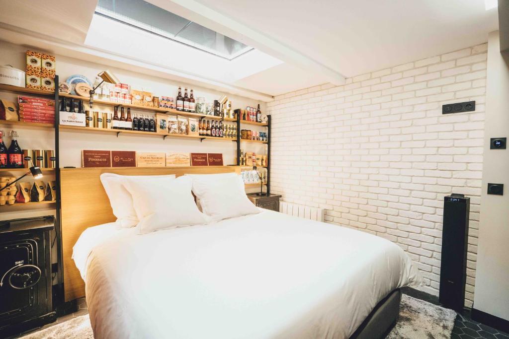 Säng eller sängar i ett rum på La suite Paris Gare de Lyon - Bastille