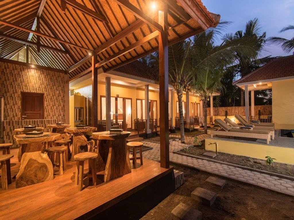 Ein Restaurant oder anderes Speiselokal in der Unterkunft Yellow Bridge Guest House