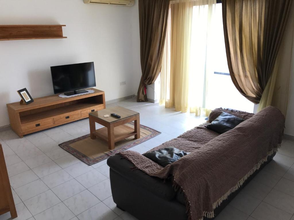 A television and/or entertainment center at Swieqi Semi Detached Maisonette