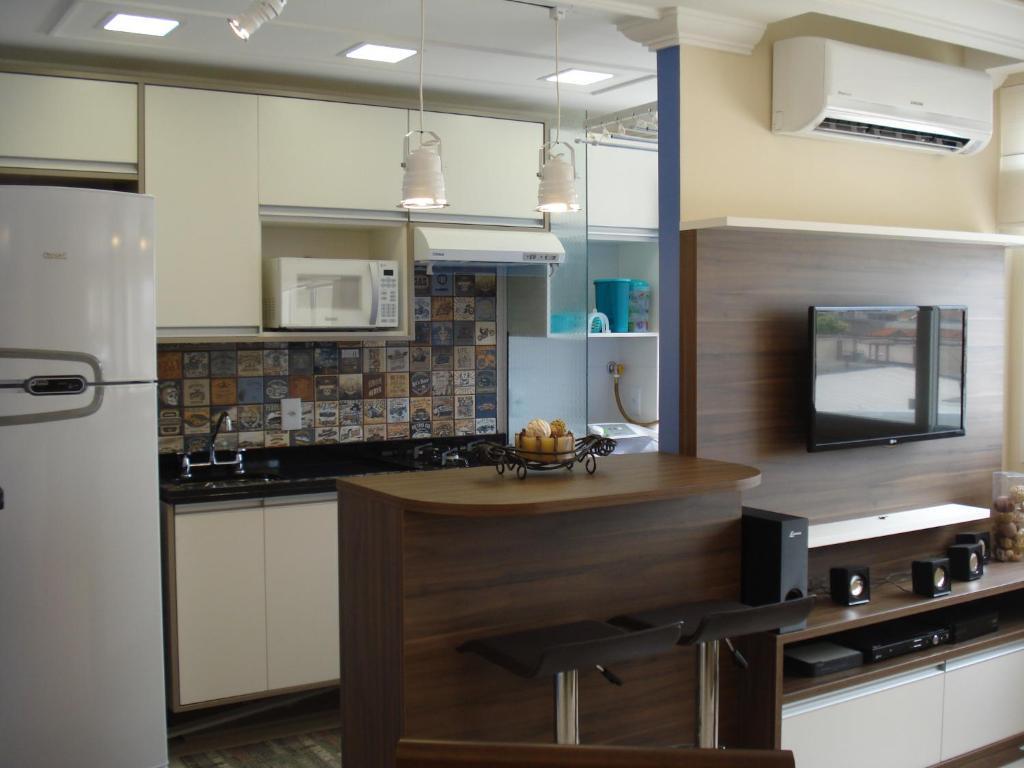 A kitchen or kitchenette at Apartamento Menino Deus