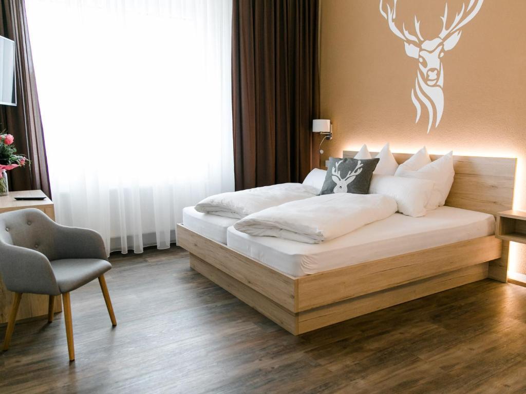 Ein Bett oder Betten in einem Zimmer der Unterkunft Schlemmerhütte - Hotel