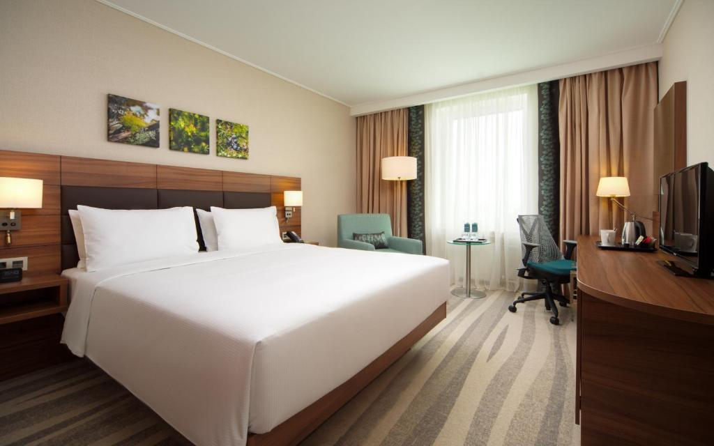 A bed or beds in a room at Hilton Garden Inn Moscow Krasnoselskaya