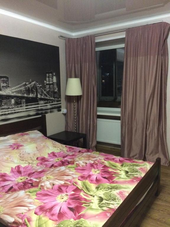 Кровать или кровати в номере Апартаменты Всполье 4