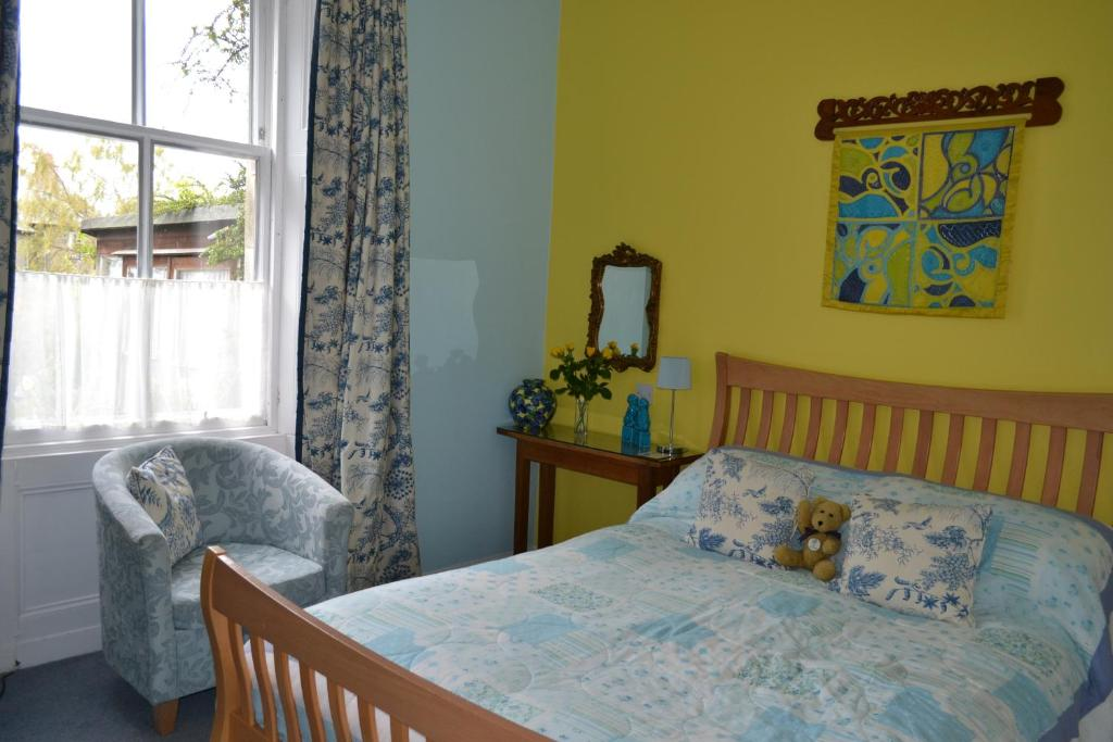A bed or beds in a room at The Spindle B&B