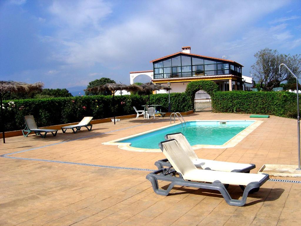 The swimming pool at or near Casa Rural La Sierra de Monfragüe