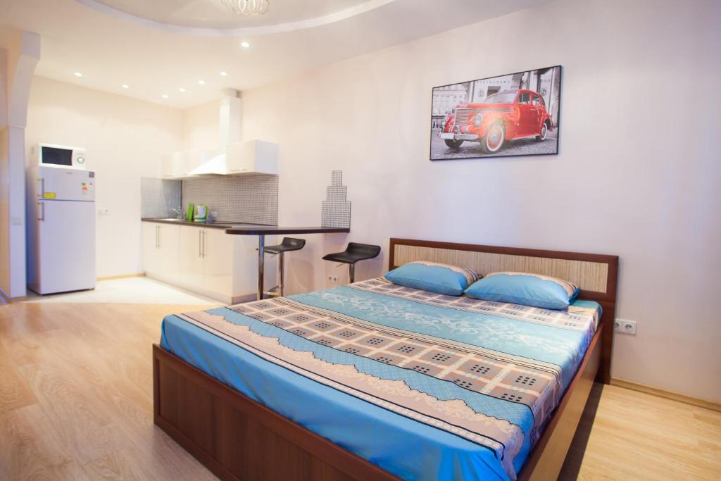 Кровать или кровати в номере Apartment in the Center on Maslennikova 72