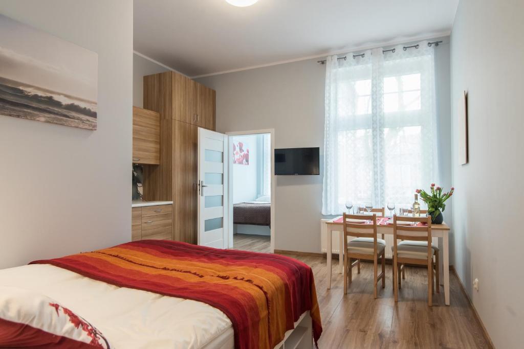 Telewizja i/lub zestaw kina domowego w obiekcie Sopot Host Patio
