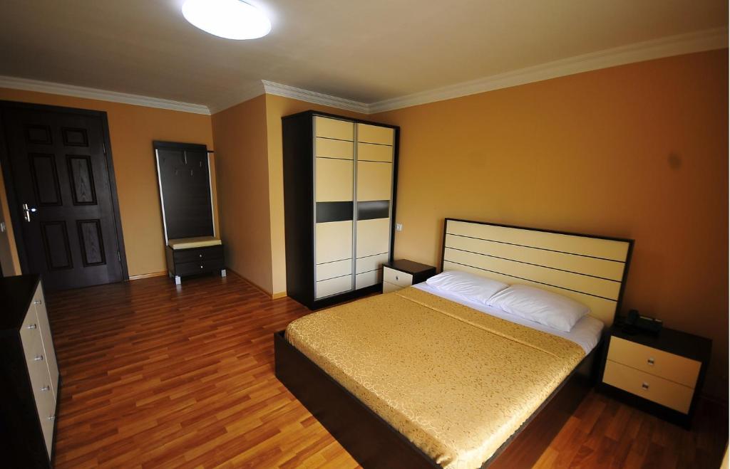 Кровать или кровати в номере Отель Престиж