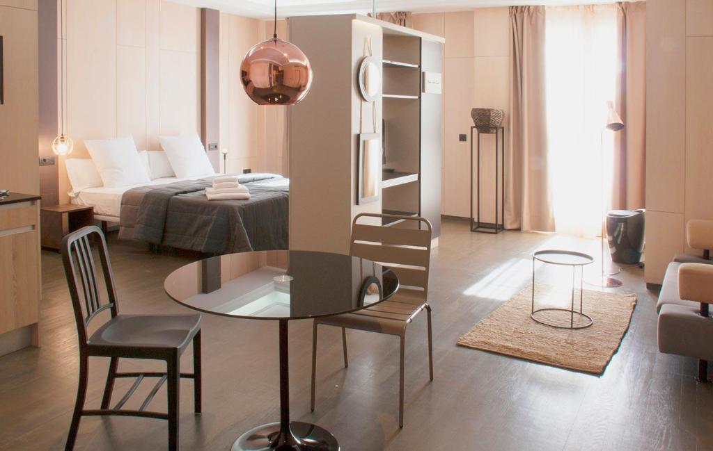 A restaurant or other place to eat at Apartamentos NONO by Charming Stay