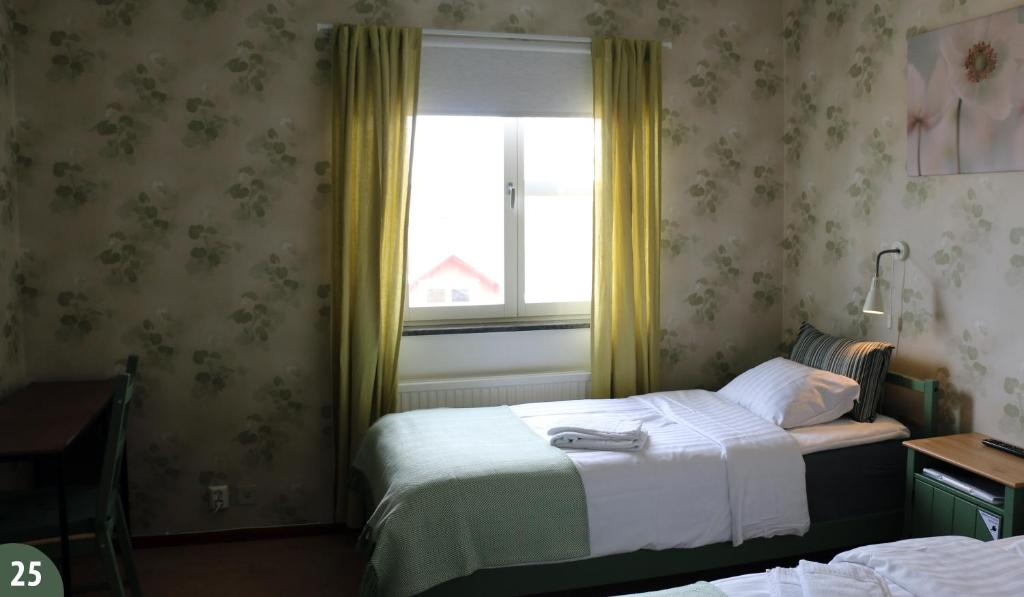 Vuode tai vuoteita majoituspaikassa Svefi Vandrarhem - Hostel