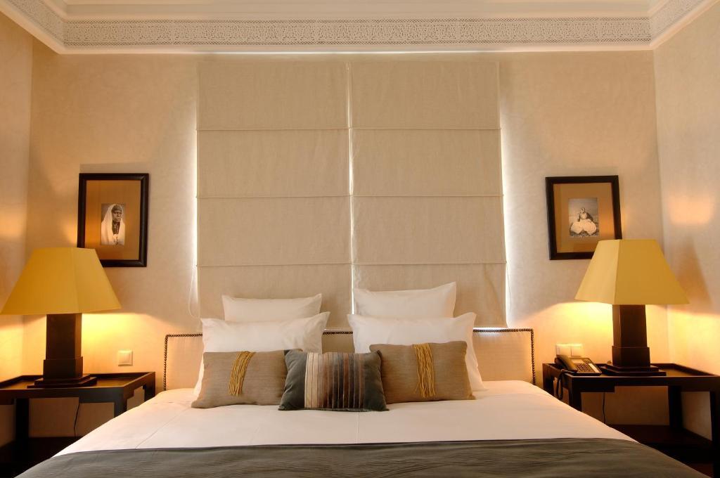 Un ou plusieurs lits dans un hébergement de l'établissement Le Riad Villa Blanche