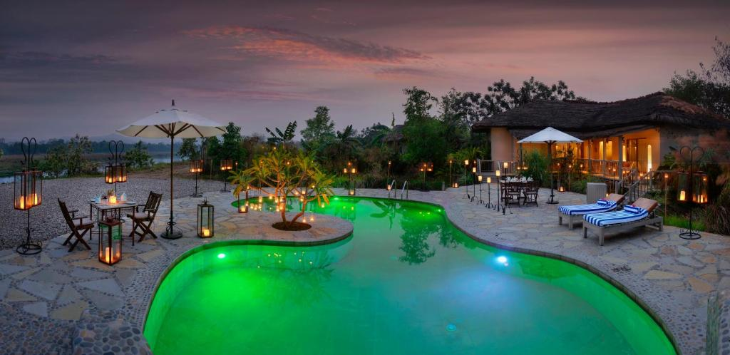 The swimming pool at or near Barahi Jungle Lodge