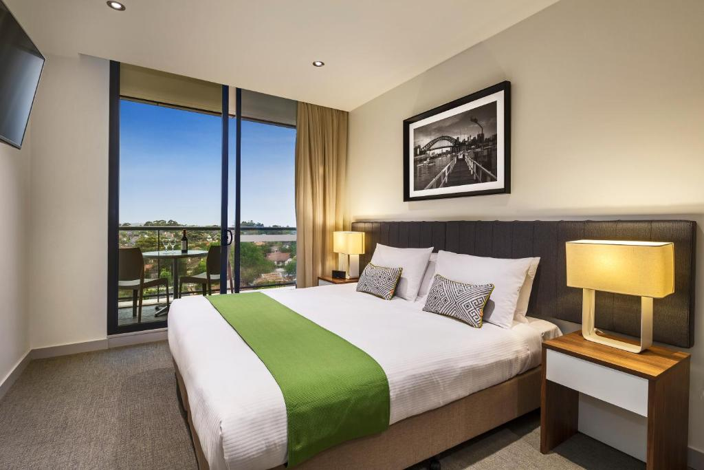 A bed or beds in a room at Quest Chatswood