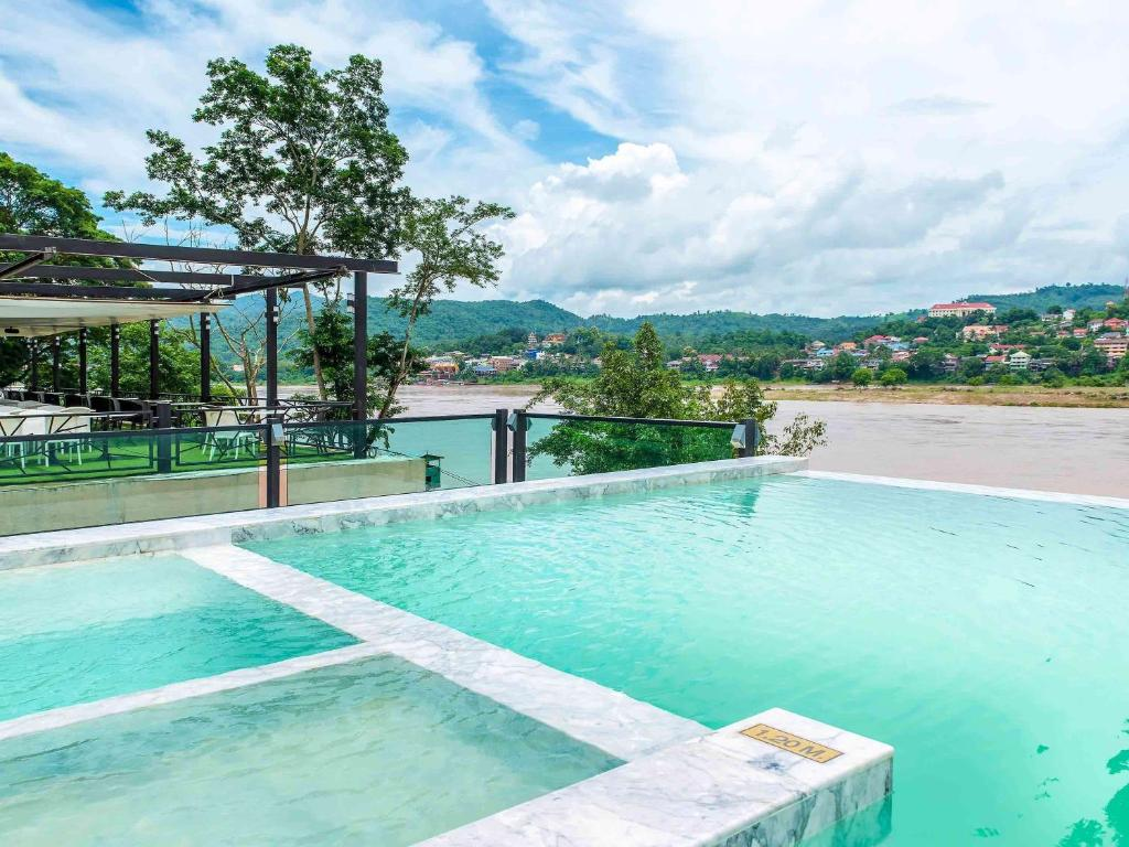The swimming pool at or near Chiangkhong Teak Garden Riverfront Onsen Hotel