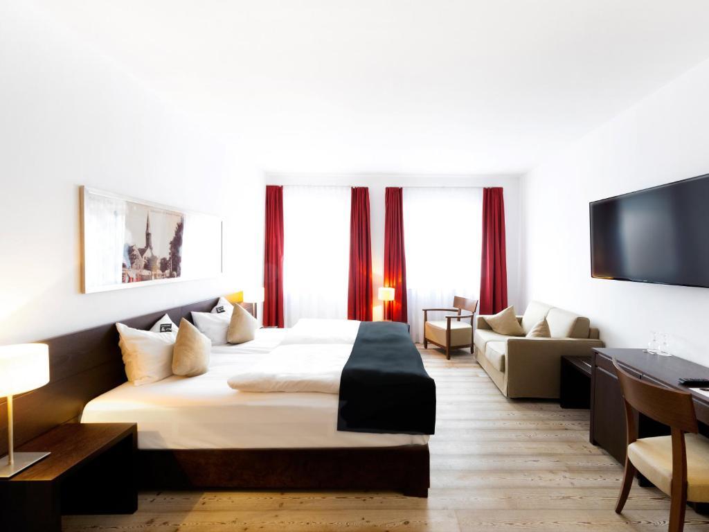 Ein Bett oder Betten in einem Zimmer der Unterkunft DORMERO Hotel Kelheim
