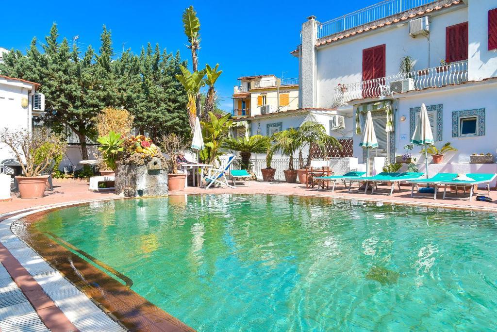 The swimming pool at or close to Charme Hotel La Villa Tina