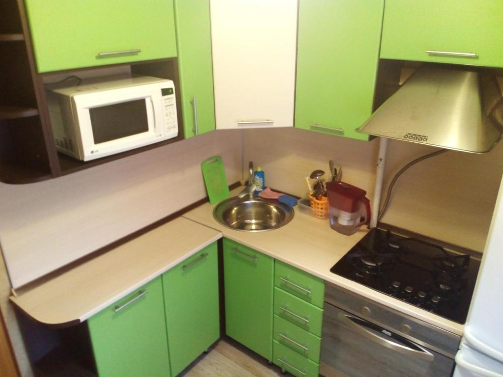 A kitchen or kitchenette at Апартамент Нефтяник
