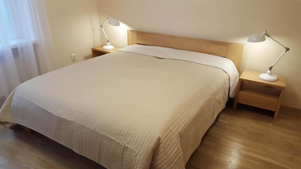 Łóżko lub łóżka w pokoju w obiekcie Apartment Katamaran