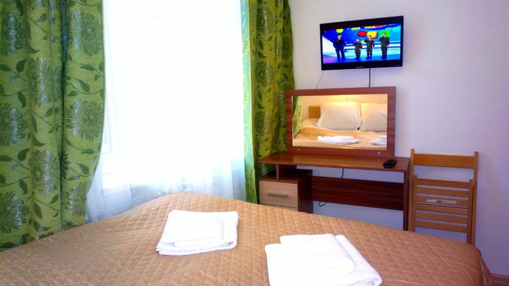 A television and/or entertainment center at Adjiutant Mini-hotel