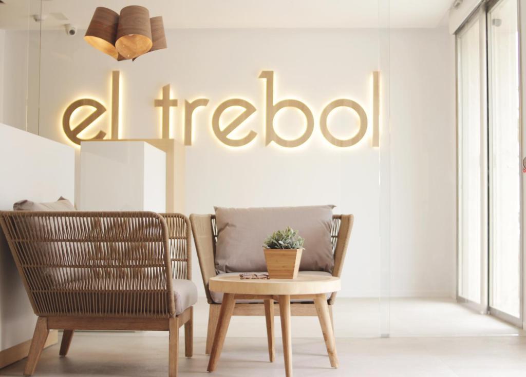 Uma área de estar em El Trebol Bar & Hotel