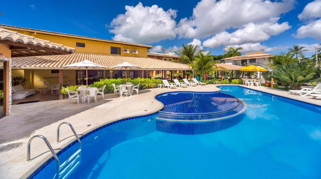The swimming pool at or near Porto Geraes Praia Hotel