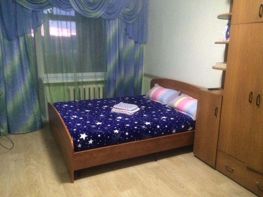 Кровать или кровати в номере Амурский бульвар 56 Вокзал жд