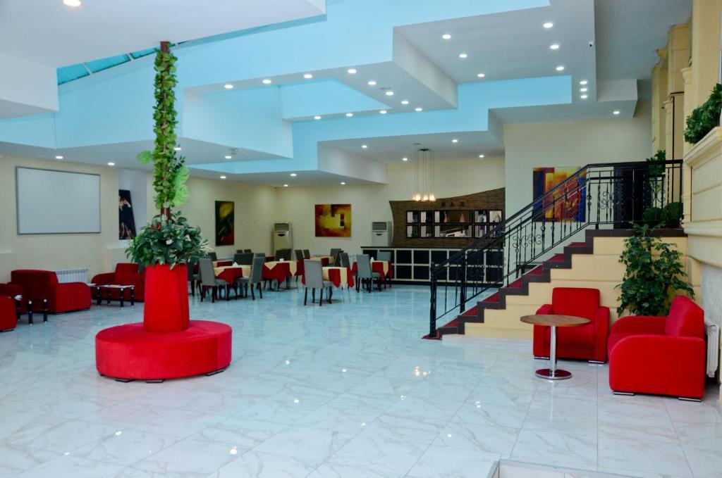 O saguão ou recepção de Ambiance Hotel