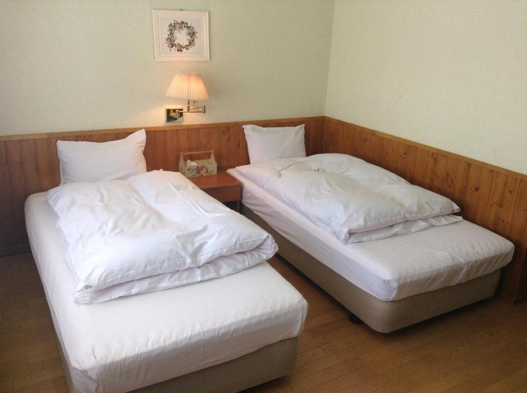 A bed or beds in a room at Niseko Pension Bellary
