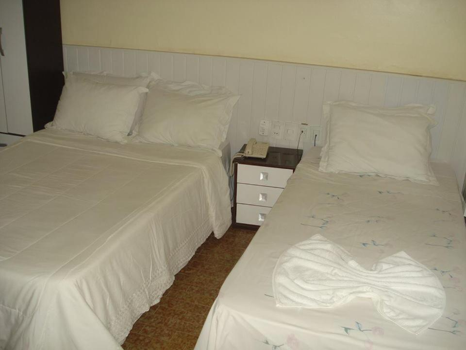 A bed or beds in a room at Panorama Hotel
