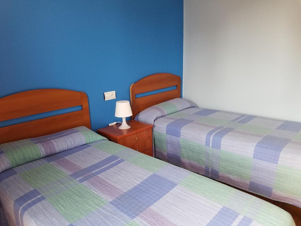 A bed or beds in a room at Hotel Condes de Buñol