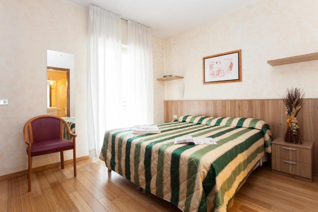 Letto o letti in una camera di Residence Desenzano