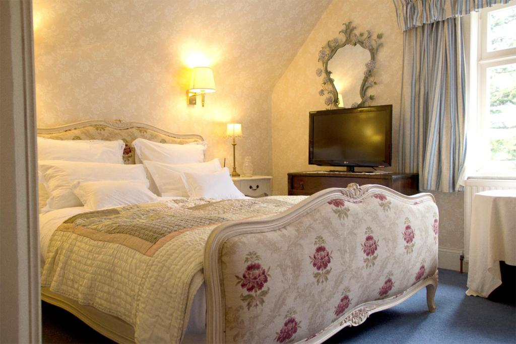 A bed or beds in a room at Corriegour Lodge Hotel